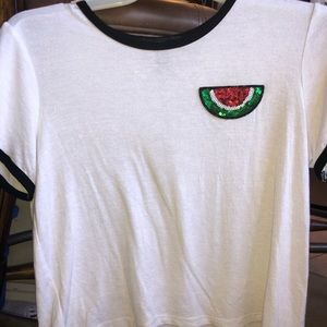 White T-shirt with a sequence watermelon slice.